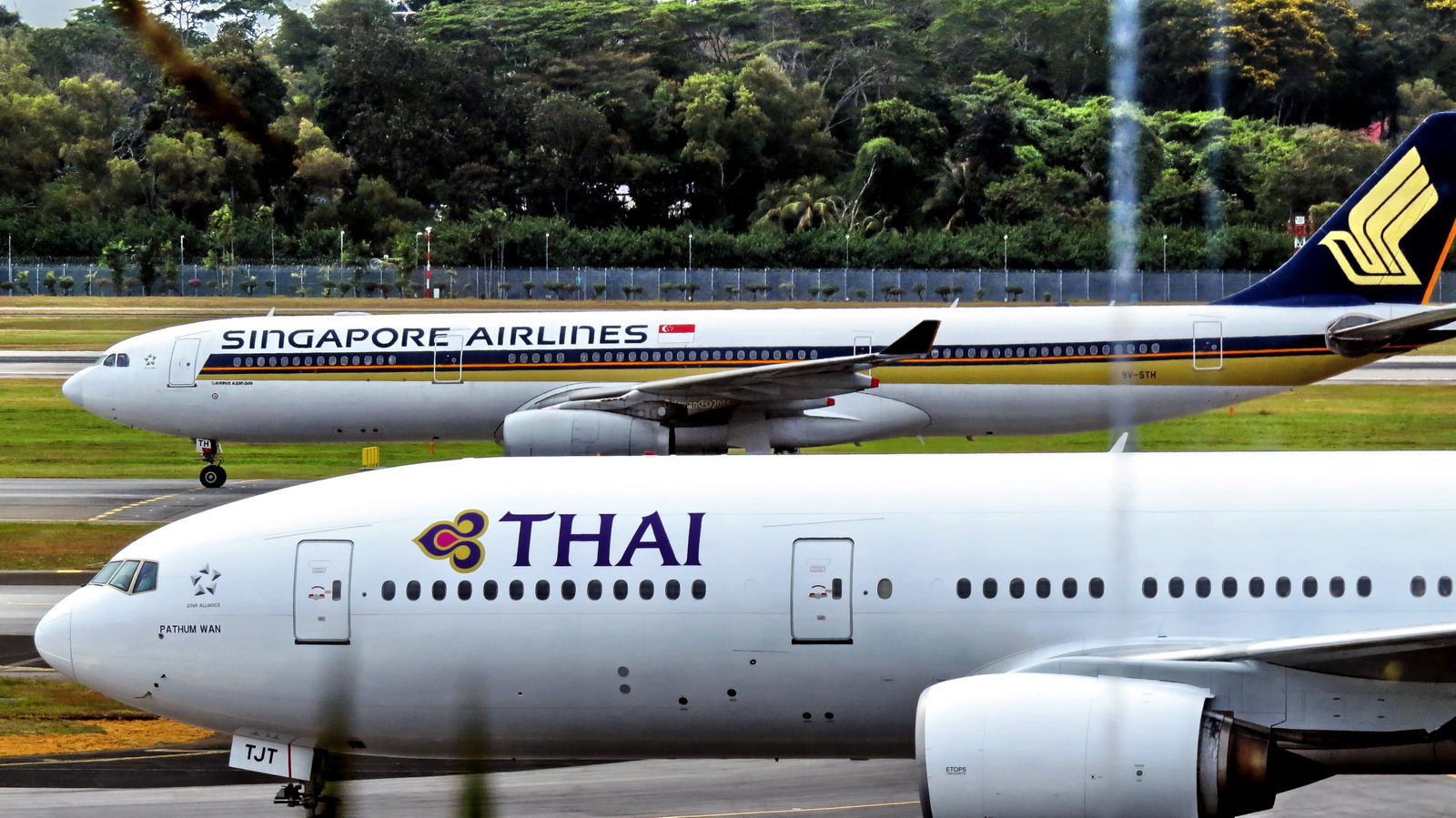 Singapore and Thai airliners on the ground